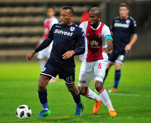 Lehlonolo Majoro of Bidvest Wits is closed down by Mosa Lebusa of Ajax Cape Town during the Absa Premiership 2017/18 game between Ajax Cape Town and Bidvest Wits at Athlone Stadium, Cape Town on 11 April 2018 © Ryan Wilkisky/BackpagePix