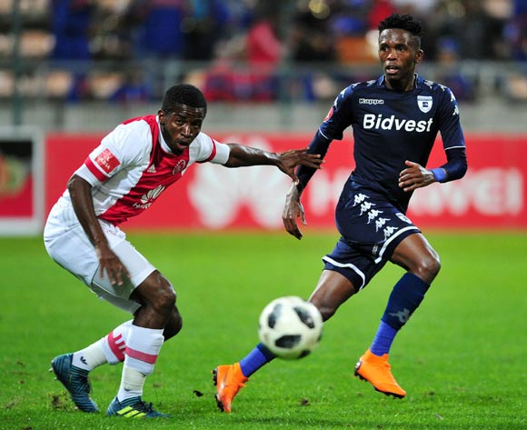Thabang Monare of Bidvest Wits gets his pass away under pressure form Gerald Takwara of Ajax Cape Town during the Absa Premiership 2017/18 game between Ajax Cape Town and Bidvest Wits at Athlone Stadium, Cape Town on 11 April 2018 © Ryan Wilkisky/BackpagePix