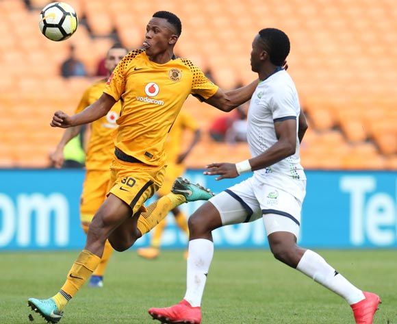 Siyabonga Ngezana of Kaizer Chiefs clears ball from Bongi Ntuli of Platinum Stars during the Absa Premiership 2017/18 match between Kaizer Chiefs and Platinum Stars at FNB Stadium, Johannesburg on 15 April 2018 ©Muzi Ntombela/BackpagePix