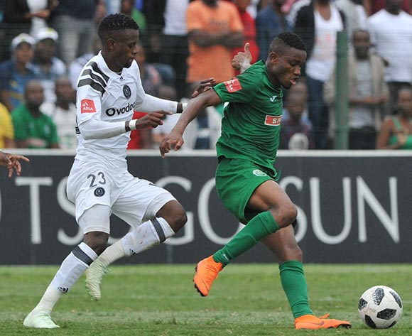 Innocent Maela of Orlando Pirates challenges Ovidy Karuru of AmaZulu  during the Absa Premiership match between AmaZulu and Orlando Pirates 15 April  2018 at King Zwelithini Stadium, Durban  Pic Sydney Mahlangu/BackpagePix