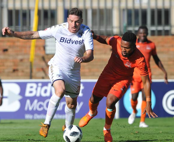Edgar Manaka of Polokwane City challenges James Keene of Bidvest Wits during the Absa Premiership match between Bidvest Wits and Polokwane City  22 April  2018 at Bidvest Stadium  Pic Sydney Mahlangu/BackpagePix