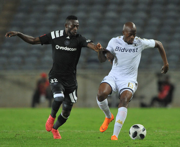 Augustine Mulenga of Orlando Pirates challenges Sifiso Hlanti of Bidvest Wits during the Absa Premiership match between Orlando Pirates and Bidvest Wits  25 April  2018 at Orlando Stadium  Pic Sydney Mahlangu/BackpagePix