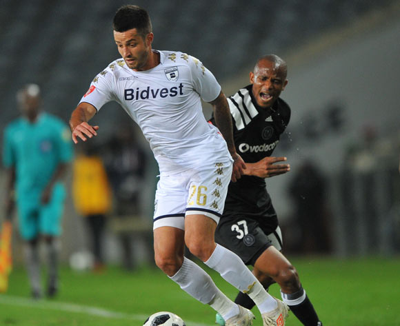 Xola Mlambo of Orlando Pirates challenges Keegan Ritchie of Bidvest Wits during the Absa Premiership match between Orlando Pirates and Bidvest Wits  25 April  2018 at Orlando Stadium  Pic Sydney Mahlangu/BackpagePix