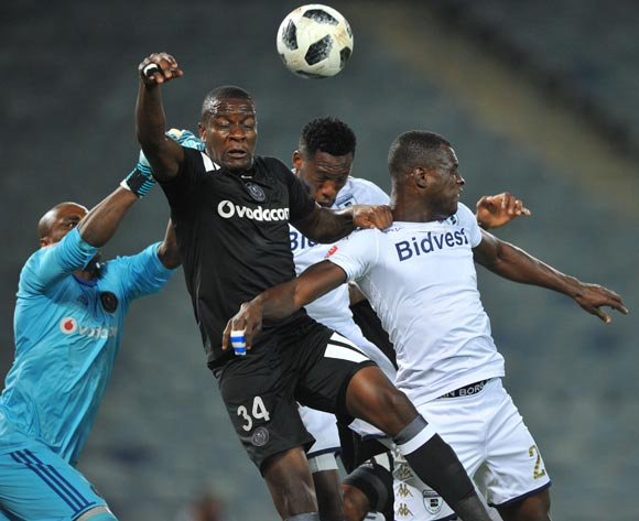Ntsikelelo Nyauza of Orlando Pirates challenges Edwin Gyimah of Bidvest Wits during the Absa Premiership match between Orlando Pirates and Bidvest Wits  25 April  2018 at Orlando Stadium  Pic Sydney Mahlangu/BackpagePix