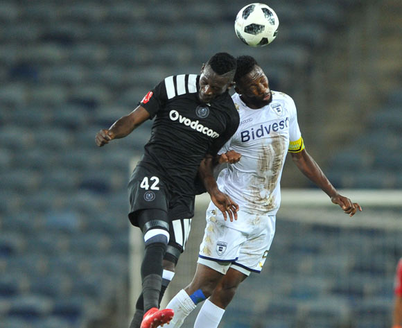 Augustine Mulenga of Orlando Pirates is challenged by Buhle Mkhwanazi of Bidvest Wits during the Absa Premiership match between Orlando Pirates and Bidvest Wits 25 April  2018 at Orlando Stadium  Pic Sydney Mahlangu/BackpagePix