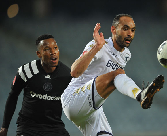 Eleazar Rodgers of Bidvest Wits is challenged by Happy Jele of Orlando Pirates during the Absa Premiership match between Orlando Pirates and Bidvest Wits  25 April  2018 at Orlando Stadium  Pic Sydney Mahlangu/BackpagePix