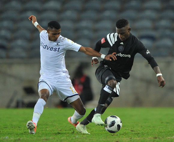 Vincent Pule of Bidvest Wits challenges Innocent Maela of Orlando Pirates  during the Absa Premiership match between Orlando Pirates and Bidvest Wits  25 April  2018 at Orlando Stadium  Pic Sydney Mahlangu/BackpagePix