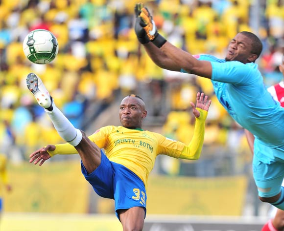 Khama Billiat of mamelodi Sundowns challenged by Jody February of Ajax Cape Town during the Absa Premiership 2017/18 football match between Mamelodi Sundowns and Ajax Cape Town at Lucas Moripe Stadium, Rustenburg on 28 April 2018 ©Samuel Shivambu/BackpagePix