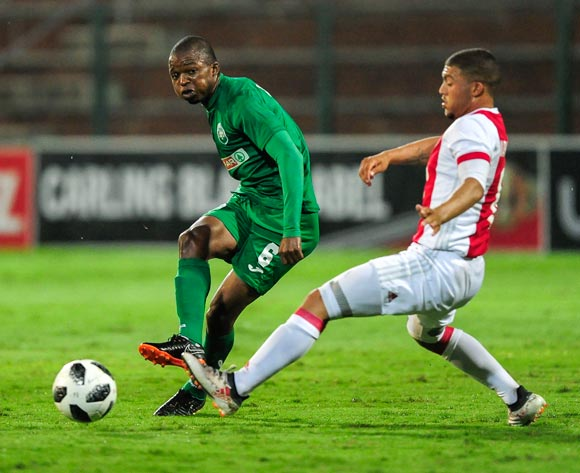 Butholezwe Ncube of AmaZulu FC boots the ball past Jabulani Ncobeni of Ajax Cape Town during the Absa Premiership 2017/18 game between AmaZulu and Ajax Cape Town at King Zwelithini Stadium, KwaZulu-Natal on 3 April 2018 © Gerhard Duraan/BackpagePix