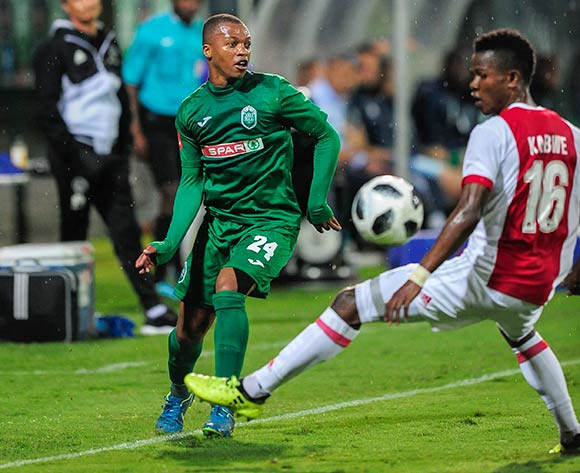 Thembela Sikhakhane of AmaZulu FC pushes the ball past Rodrick Kabwe of Ajax Cape Town F.C. during the Absa Premiership 2017/18 game between AmaZulu and Ajax Cape Town at King Zwelithini Stadium, KwaZulu-Natal on 3 April 2018 © Gerhard Duraan/BackpagePix
