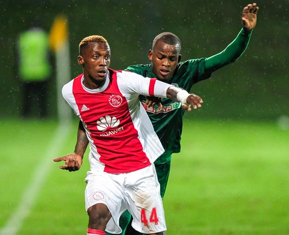 Mpendulo Dlamini of Ajax Cape Town boots the ball despite the efforts of Phumlani Gumede of AmaZulu FC during the Absa Premiership 2017/18 game between AmaZulu and Ajax Cape Town at King Zwelithini Stadium, KwaZulu-Natal on 3 April 2018 © Gerhard Duraan/BackpagePix