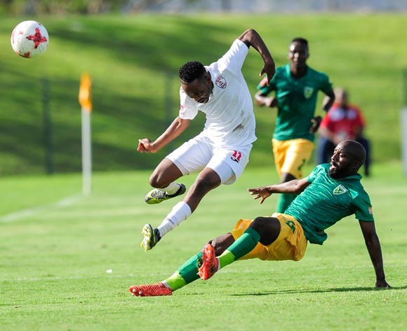 Sandile Zuke of Lamontville Golden Arrows slides in and defends the attack from Sinethemba Jantjie of Free State Stars FC during the Absa Premiership 2017/18 game between Golden Arrows and Free State Stars at Princess Magogo Stadium, KwaZulu-Natal on 7 April 2018 © Gerhard Duraan/BackpagePix
