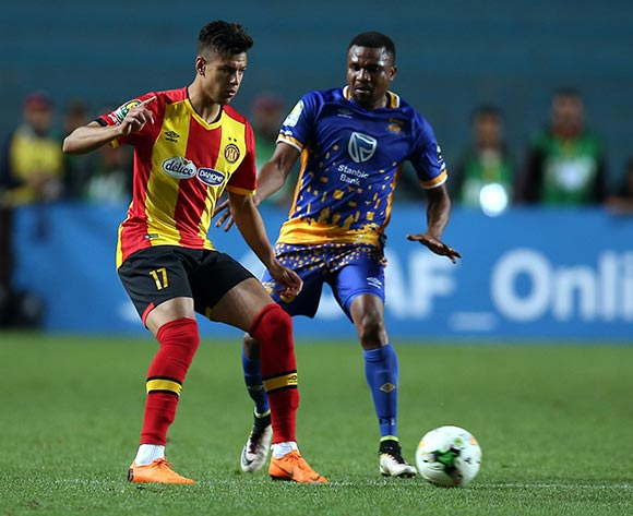 epa06740498 Esperance  Sportive de Tunis  player Mohamed Maher Ben Sghaier  (L) and Township Rollers player  Tshepo Motlhabankwe  (R) fight for the ball during the CAF Champions League soccer match between Espérance sportive de Tunis of Tunisia and Township Rollers of Botswana at the Olympic Stadium Rades in Tunis, Tunisia, 15 May 2018.  EPA/MOHAMED MESSARA