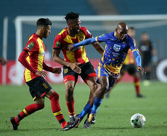 epa06740503 Esperance Sportive de Tunis  players Anice Badri  (L)  Fousseny Coulibaly  (R) and Township Rollers player  Ali Machani (C) fight for the ball during the CAF Champions League soccer match between Espérance sportive de Tunis of Tunisia and Township Rollers of Botswana at the Olympic Stadium Rades in Tunis, Tunisia, 15 May 2018.  EPA/MOHAMED MESSARA
