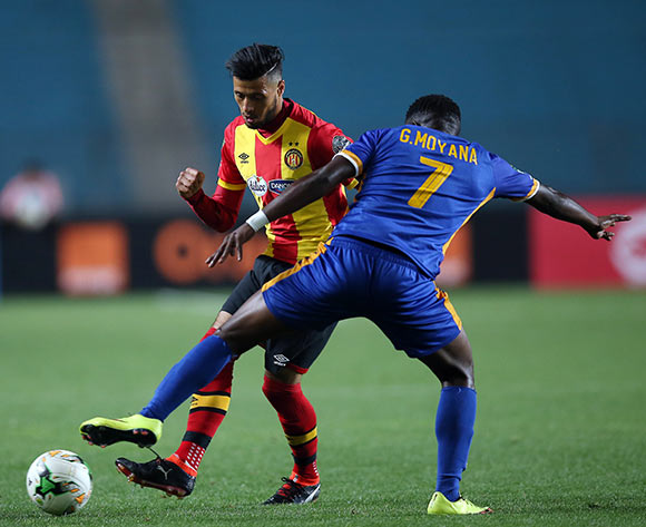 epa06740504 Esperance Sportive de Tunis  player Anice Badri (L) and Township Rollers player  Ademibi Rdjae (R) fight for the ball during the CAF Champions League soccer match between Espérance sportive de Tunis of Tunisia and Township Rollers of Botswana at the Olympic Stadium Rades in Tunis, Tunisia, 15 May 2018.  EPA/MOHAMED MESSARA