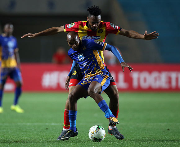 epa06740505 Esperance portive de Tunis  players   Fousseny Coulibaly  and Township Rollers player  Ali Machani (front) fight for the ball during the CAF Champions League soccer match between Espérance sportive de Tunis of Tunisia and Township Rollers of Botswana at the Olympic Stadium Rades in Tunis, Tunisia, 15 May 2018.  EPA/MOHAMED MESSARA