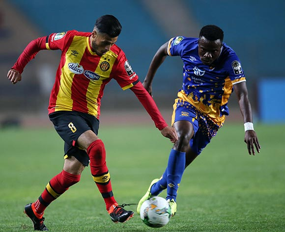 Esperance Sportive de Tunis  player Anice Badri (L) and Township Rollers player  Ademibi Rdjae (R) fight for the ball during the CAF Champions League soccer match between Espérance sportive de Tunis of Tunisia and Township Rollers of Botswana at the Olympic Stadium Rades in Tunis, Tunisia, 15 May 2018.  EPA/MOHAMED MESSARA