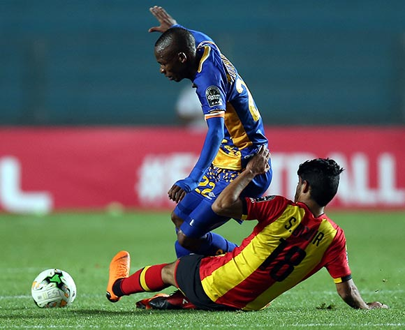 Esperance Sportive de Tunis  playerSaad Beguir   (on the ground) and Township Rollers player   Maano Ditshupo   (standing) fight for the ball during the CAF Champions League soccer match between Espérance sportive de Tunis of Tunisia and Township Rollers of Botswana at the Olympic Stadium Rades in Tunis, Tunisia, 15 May 2018.  EPA/MOHAMED MESSARA