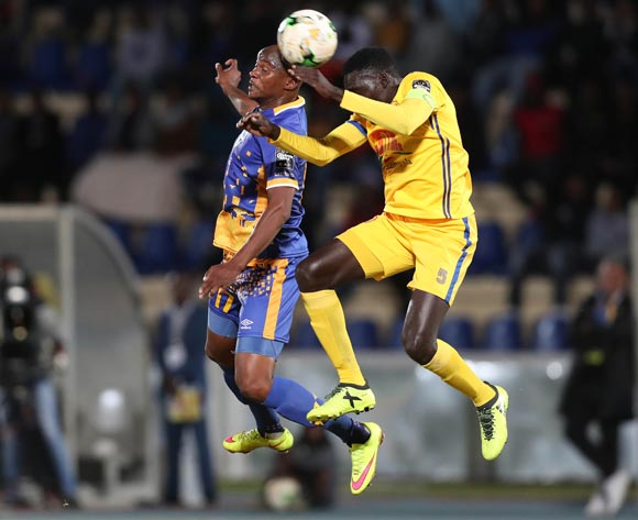 Joel Mogorosi of Township Rollers challenged by Awany Timothy Dennis of KCCA during the 2018 CAF Champions League football match between Township Rollers and KCCA at the National Stadium, Gaborone, Botswana on 04 May 2018 ©Gavin Barker/BackpagePix