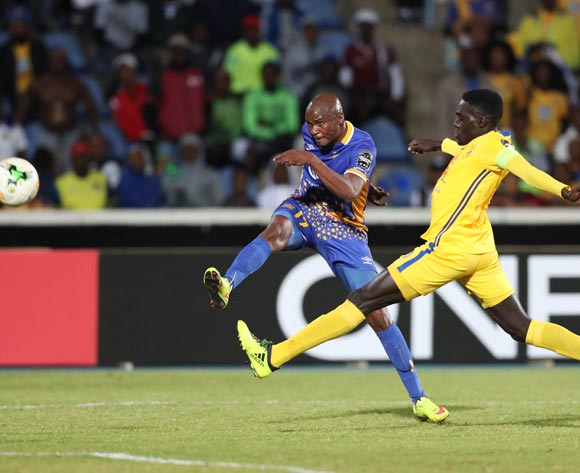Joel Mogorosi of Township Rollers shoots challenged by Awany Timothy Dennis of KCCA during the 2018 CAF Champions League football match between Township Rollers and KCCA at the National Stadium, Gaborone, Botswana on 04 May 2018 ©Gavin Barker/BackpagePix