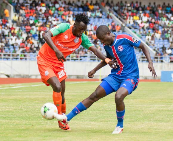 Zesco United FC striker Jesse Jackson Were in tussle against Sanele Justice Mkhweli of Mbabane Swallows during the 2018 CAF Champions League football match between Zesco United FC and Mbabane Swallows at the Levy Mwanawasa Stadium in Ndola on 05 May 2018 ©BackpagePi