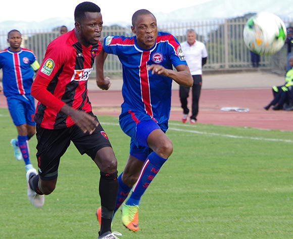 Masunguna Alex Afonso of Club Desportivo 1 de Agosto runs for the ball with Sandile Hlathswako of Mbabane Swallows during the 2018 CAF Champions League football match between Mbabane Swallows and Club Desportivo 1 de Agosto at the Mavuso Sports Centre,Swaziland on 15 May 2018 ©BackpagePix
