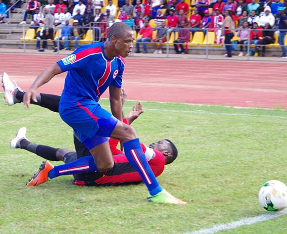 Sandile Hlatshwako of Mbabane Swallows goes for the ball while Masunguna Alex Afonso of Club Desportivo 1 de Agosto falls during the 2018 CAF Champions League football match between Mbabane Swallows and Club Desportivo 1 de Agosto at the Mavuso Sports Centre,Swaziland on 15 May 2018 ©BackpagePix