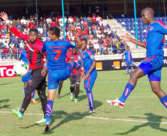 Felix Badenhorst and Sanele Mkheli of Mbabane Swallows go for goal while Bakulu Bitumba Jacques of Club Desportivo 1 de Agosto tries to defend during the 2018 CAF Champions League football match between Mbabane Swallows and Club Desportivo 1 de Agosto at the Mavuso Sports Centre,Swaziland on 15 May 2018 ©BackpagePix