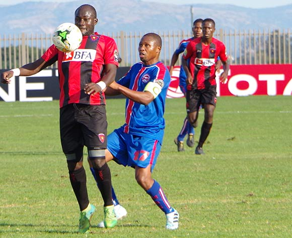 Isaac Correia Da Costa Da Costa of Club Desportivo 1 de Agosto  controls the ball under pressure from Tony Tsabedze of Mbabane Swallows during the 2018 CAF Champions League football match between Mbabane Swallows and Club Desportivo 1 de Agosto at the Mavuso Sports Centre,Swaziland on 15 May 2018 ©BackpagePix