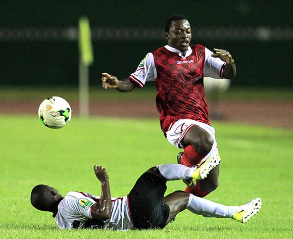 Yao Kouassi Attohoula of Williamsville Athletic Club of Ivory Coast (R) vies for the ball with Okiele Mimile Olfaga (L) from Club Athletique Renaissance Aiglons of Congo during their CAF Confederation Cup match group phase between Williamsville Athletic Club  and Club Athletique Renaissance Aiglons of Congo at the Felix Houphouet-Boigny stadium in Abidjan, Ivory Coast, 06 May 2018.