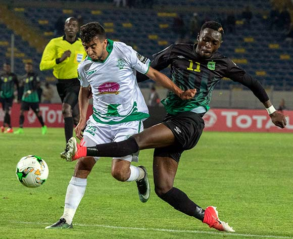 Raja Club Athletic player Omar Boutayeb (L) in action against AS Vita Club player  Chadrack Muzungu Lukombe  (R) during the African Confederation Cup 2018 qualifying  soccer match between  Raja Club Athletic from Morocco and AS Vita Club  from Congo at Prince Moulay Abdellah Stadiumin Rabat, Morocco, 06 May 2018.