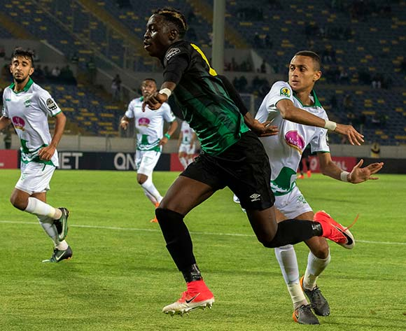 Raja Club Athletic player s in action against AS Vita Club player    Chadrack Muzungu Lukombe (C) during the African Confederation Cup 2018 qualifying  soccer match between  Raja Club Athletic from Morocco and AS Vita Club  from Congo at Prince Moulay Abdellah Stadiumin Rabat, Morocco, 06 May 2018.