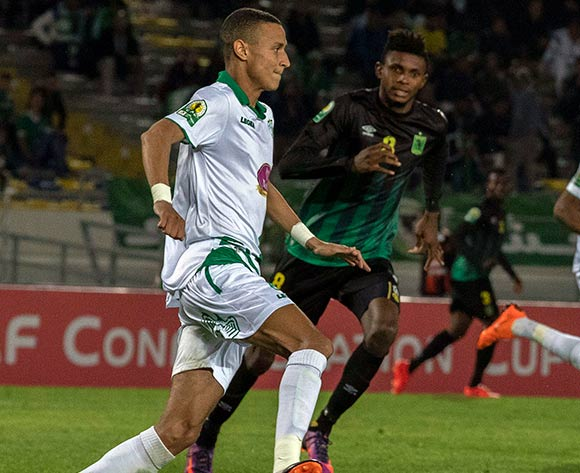 Raja Club Athletic player  (L) in action against AS Vita Club player   Fabrice Luamba Ngoma (R)  during the African Confederation Cup 2018 qualifying  soccer match between  Raja Club Athletic from Morocco and AS Vita Club  from Congo at Prince Moulay Abdellah Stadiumin Rabat, Morocco, 06 May 2018.