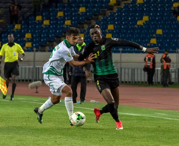 Raja Club Athletic player Saad Lakohal (L) in action against AS Vita Club player Chadrack Muzungu Lukombe  (R) during the African Confederation Cup 2018 qualifying  soccer match between  Raja Club Athletic from Morocco and AS Vita Club  from Congo at Prince Moulay Abdellah Stadiumin Rabat, Morocco, 06 May 2018.