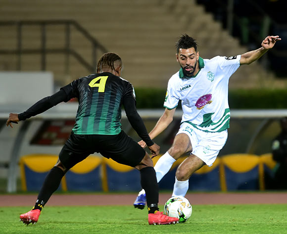 Raja Club Athletic player Mahmoud Benhalib (LR in action against AS Vita Club player Yannick Bangala Litombo (R) during the African Confederation Cup 2018 qualifying  soccer match between  Raja Club Athletic from Morocco and AS Vita Club  from Congo at Prince Moulay Abdellah Stadiumin Rabat, Morocco, 06 May 2018