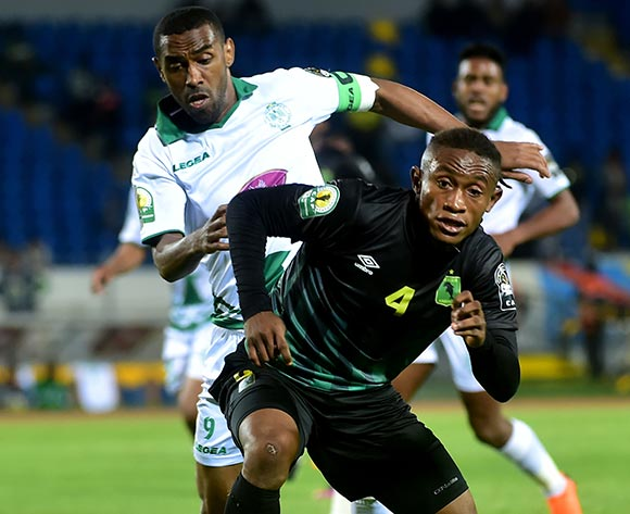 Raja Club Athletic player  Moussine Iajour  (L) in action against AS Vita Club player    Yannick Bangala Litombo    (R) during the African Confederation Cup 2018 qualifying  soccer match between  Raja Club Athletic from Morocco and AS Vita Club  from Congo at Prince Moulay Abdellah Stadiumin Rabat, Morocco, 06 May 2018.