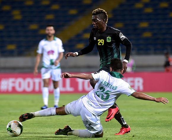 Raja Club Athletic player  Omar Boutayeb (25) in action against AS Vita Club player Makusu Mundele (29) during the African Confederation Cup 2018 qualifying  soccer match between  Raja Club Athletic from Morocco and AS Vita Club  from Congo at Prince Moulay Abdellah Stadiumin Rabat, Morocco, 06 May 2018.