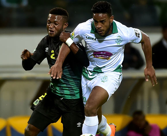 Raja Club Athletic player  Abdeljalil Jbira  (R) in action against AS Vita Club player   Emmanuel Ngudikama  (L) during the African Confederation Cup 2018 qualifying  soccer match between  Raja Club Athletic from Morocco and AS Vita Club  from Congo at Prince Moulay Abdellah Stadiumin Rabat, Morocco, 06 May 2018.