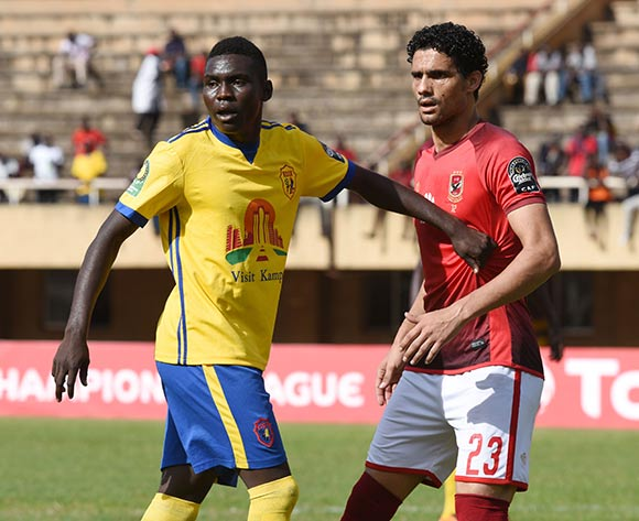 Shaban Muhammad of Kampala Capital City Authority FC (KCCA) pictured with Mohamed Naguib El Ghareeb Mohamed of Al Ahly Sporting Club during the 2018 Caf Champions League on 15 May 2018 at Mandela Stadium, Namboole, Kampala. ©Ismail Kezaala/BackpagePix