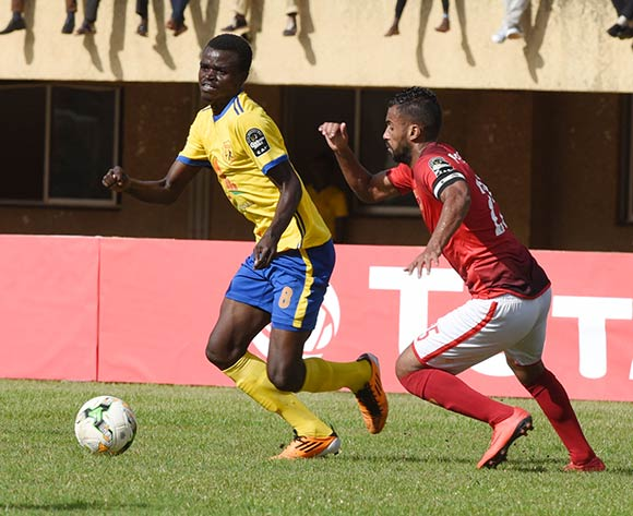 Hossam Ashour of Al Ahly Sporting Club tries to challenge Jackson Nunda of Kampala Capital City Authority FC (KCCA) during the 2018 Caf Champions League on 15 May 2018 at Mandela Stadium, Namboole, Kampala. ©Ismail Kezaala/BackpagePix