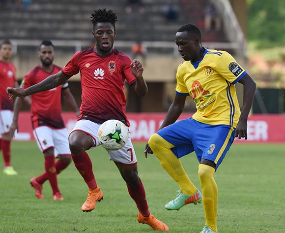 Phakamani Mahlambi of Al Ahly Sporting Club tries to challenge Lawrence Bukenya of Kampala Capital City Authority FC (KCCA) during the 2018 Caf Champions League on 15 May 2018 at Mandela Stadium, Namboole, Kampala. ©Ismail Kezaala/BackpagePix