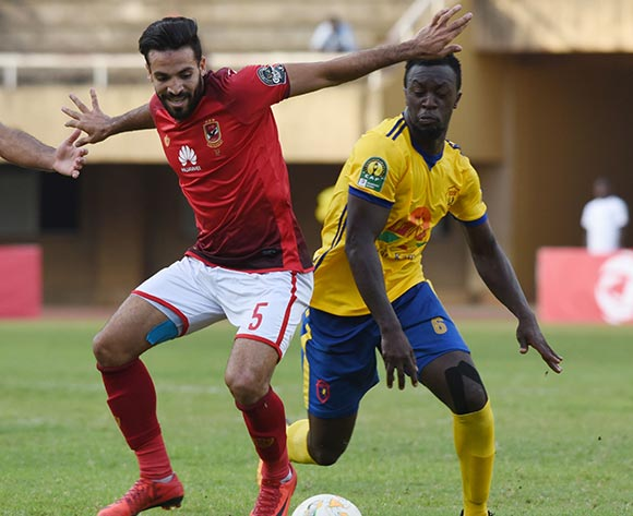 Juma Sadam Ibrahim of Kampala Capital City Authority FC (KCCA) tries to challenge Islam Mohareb of Al Ahly Sporting Club during the 2018 Caf Champions League on 15 May 2018 at Mandela Stadium, Namboole, Kampala. ©Ismail Kezaala/BackpagePix