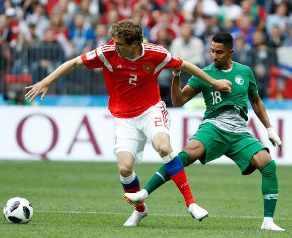 epa06807262 Mario Fernandes of Russia (L) and Salem Al-Dawsari of Saudi Arabia (R) in action during the FIFA World Cup 2018 group A preliminary round soccer match between Russia and Saudi Arabia in Moscow, Russia, 14 June 2018.