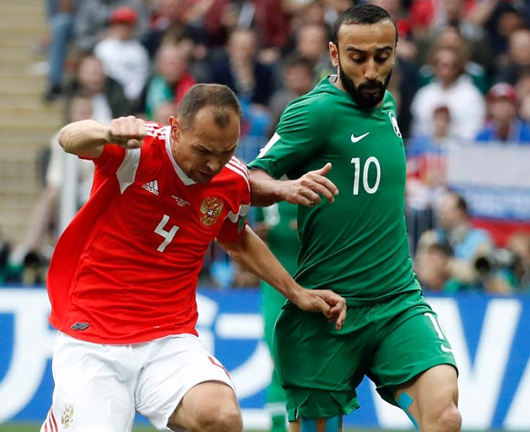 epa06807316 Mohammad Al-Sahlawi of Saudi Arabia and Sergei Ignashevich of Russia (L) in action during the FIFA World Cup 2018 group A preliminary round soccer match between Russia and Saudi Arabia in Moscow, Russia, 14 June 2018.