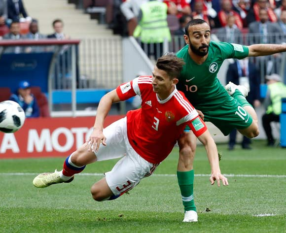 epa06807337 Mohammad Al-Sahlawi of Saudi Arabia (R) and Ilya Kutepov of Russia in action during the FIFA World Cup 2018 group A preliminary round soccer match between Russia and Saudi Arabia in Moscow, Russia, 14 June 2018.