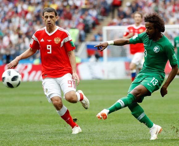 epa06807347 Alan Dzagoev of Russia (L) and Yasir Al-Shahrani of Saudi Arabia in action during the FIFA World Cup 2018 group A preliminary round soccer match between Russia and Saudi Arabia in Moscow, Russia, 14 June 2018.