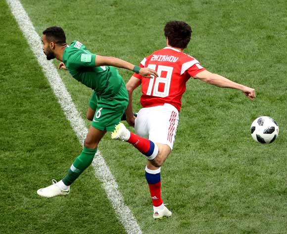 epa06807471 Mohammed Alburayk (L) of Saudi Arabia and  Yuri Zhirkov of Russia in action during the FIFA World Cup 2018 group A preliminary round soccer match between Russia and Saudi Arabia in Moscow, Russia, 14 June 2018.