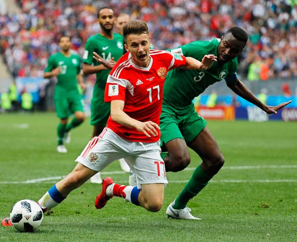epa06807548 Aleksandr Golovin (L) of Russia in action against Osama Hawsawi (R) of Saudi Arabia during the FIFA World Cup 2018 group A preliminary round soccer match between Russia and Saudi Arabia in Moscow, Russia, 14 June 2018.
