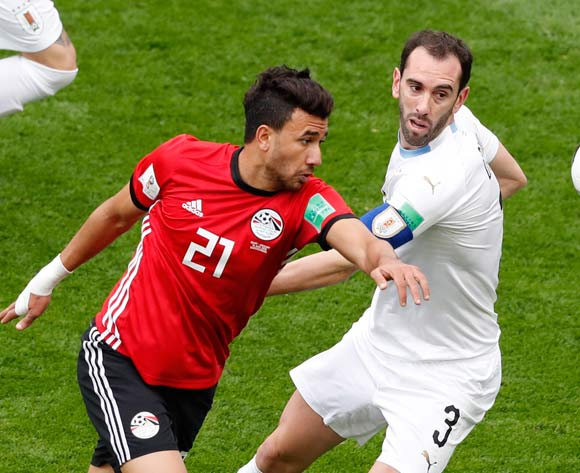 epa06809703 Trezeguet (L) of Egypt and Diego Godin of Uruguay in action during the FIFA World Cup 2018 group A preliminary round soccer match between Egypt and Uruguay in Ekaterinburg, Russia, 15 June 2018.