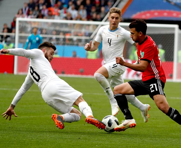 epa06809788 Trezeguet of Egypt (R) and Nahitan Nandez of Uruguay (L) in action during the FIFA World Cup 2018 group A preliminary round soccer match between Egypt and Uruguay in Ekaterinburg, Russia, 15 June 2018.